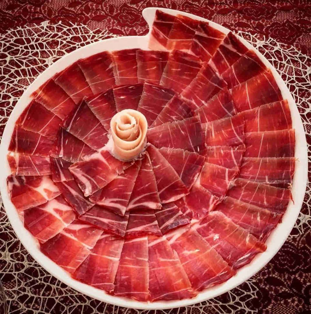food and wine tours spain jamon iberico sliced by knife